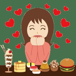 甘いお菓子を目の前に並べて喜んでいる女性の画像