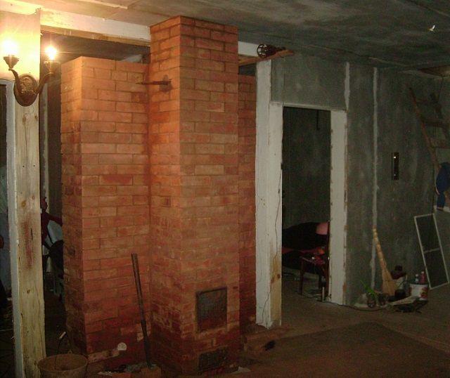 Ugnen kan enkelt utföra rollen som en plats på väggarna mellan rum.