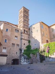 Monastic cloisters and a Romanesque bell-tower in Piazza di Ss. Giovanni e Paolo.