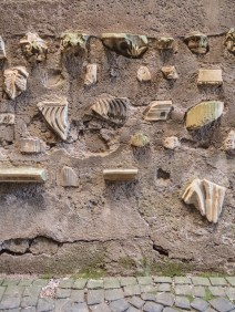 Fragments of ancient sarcophagi embedded into a wall outside Santi Giovanni e Paolo.