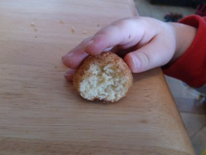 My youngest son giving our gluten-free doughnut holes is seal of approval