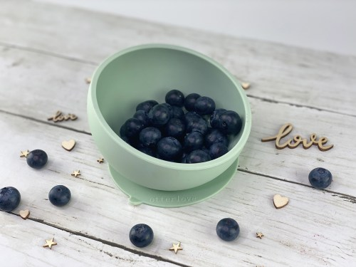 ergonomic silicone baby feeding bowl with suction base - sage - healthy toddler snacks - blueberries