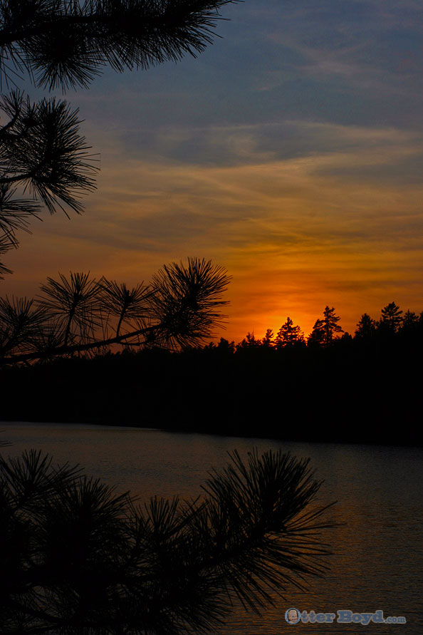 Muskoka sunset over lake and forest