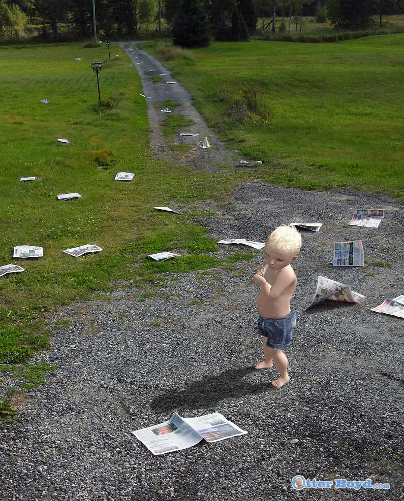 Otter Boyd boy with scattered newspapers