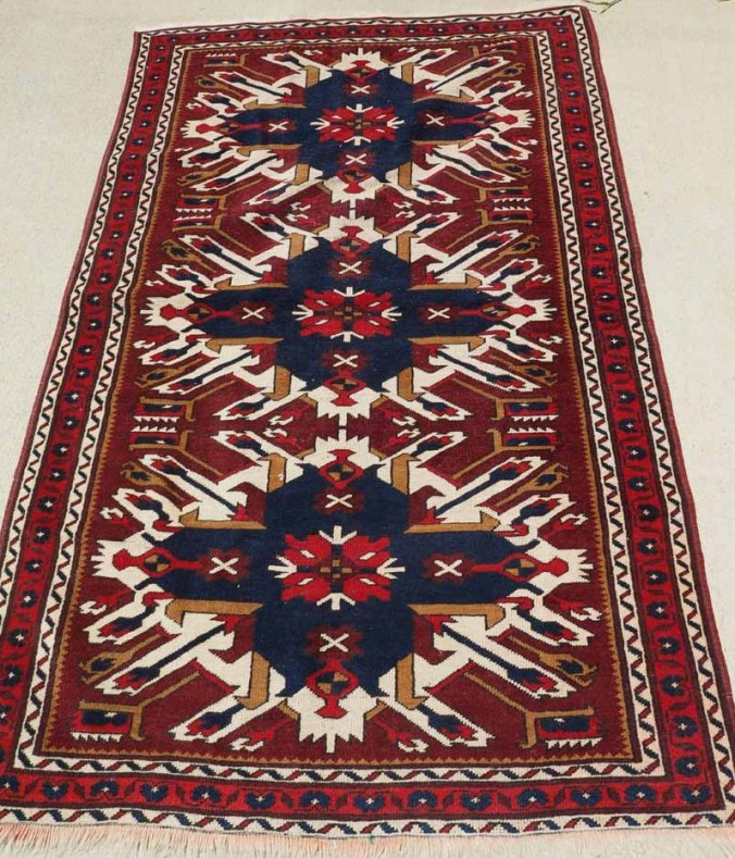 A hand knotted wool on wool Caucasian Rug from Chelaberd Karabagh Region