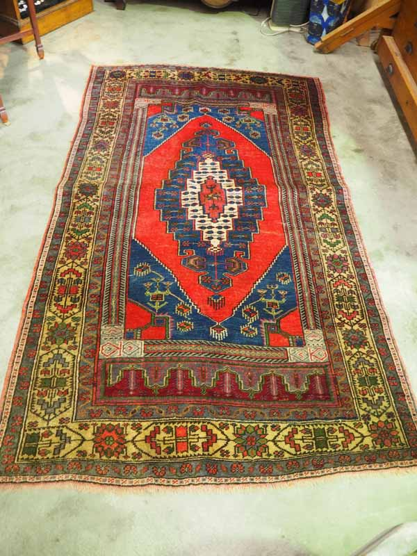 Hand made double knotted Turkish wool carpet from Yahyali. Approximately 60 years old