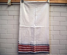 Delightful hand loomed table cloth early 20th century