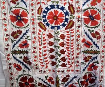 A hand silk embroidered & cotton suzani from Nurata in Uzbekistan