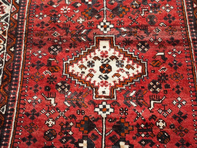 Hand knotted wool on wool Persian carpet from Shiraz, approximately 30 - 40 years old