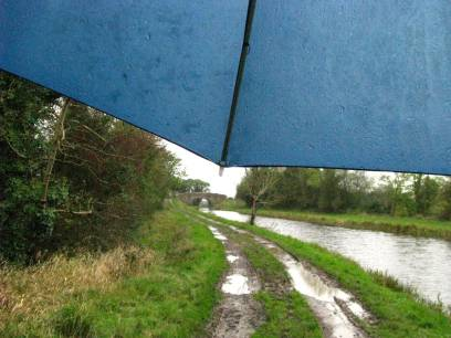 Me doing my umbrella trick again. Guy's Bridge comes into view. note the lovely smooth towpath surface... fun!