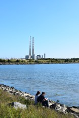 Love on the rocks? Romance, or sore bums, against the backdrop of the Poolbeg Chimneys, Dublin, Ireland