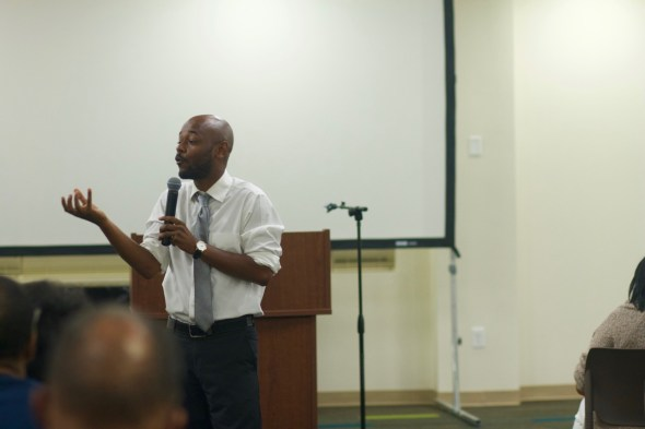 Rev. Michael Wortham, Colllege and Young Adult Pastor, presents a message on faith and politics at the mid-week service.