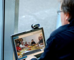 Teacher teaching a group of students via videoconference