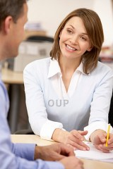 Smart smiling woman talking with man