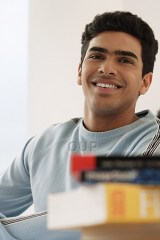 Young adult male learner smiling