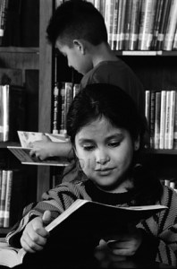 Young girl reading in a library
