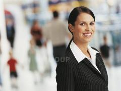 Smartly dressed young woman smiling