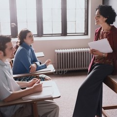 Teacher talking with her students