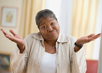 Middle aged African woman shrugging her shoulders