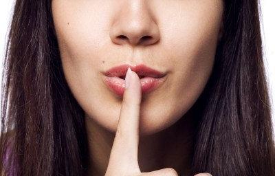 woman_holding_finger_to_her_lips_shh