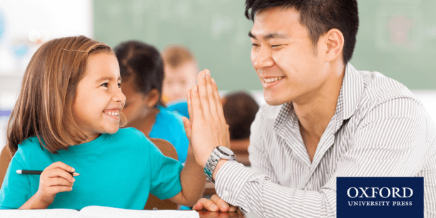 Teacher and student high-fiving