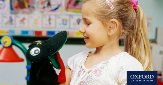 young learner using a puppet in the classroom