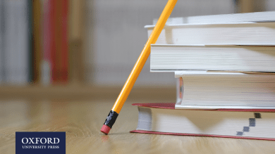 pencil leaning against a pile of books