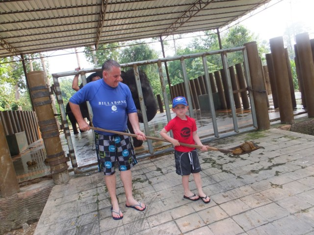 Scooping poop with dads help!