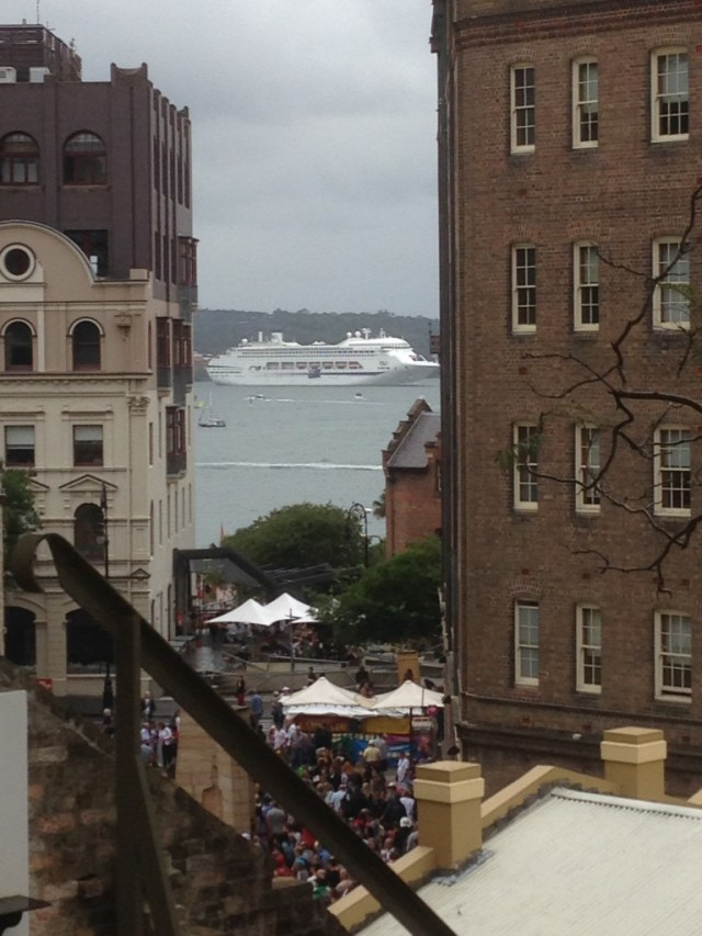 One of the P&O Cruise Ships visible through the buildings.