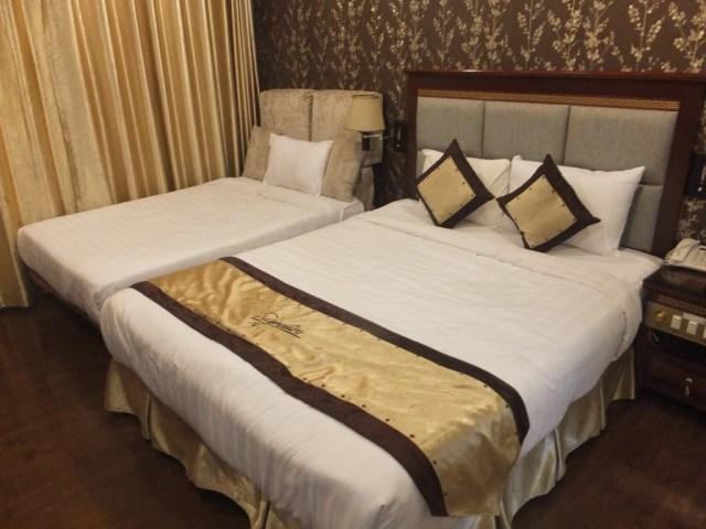 Adjoining room for the kids - Signature Saigon Hotel.