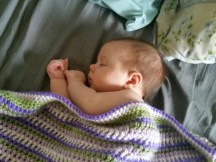 Lena with the blanket I made her.