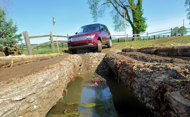 a2015 Land Rover at Rolex log bridge
