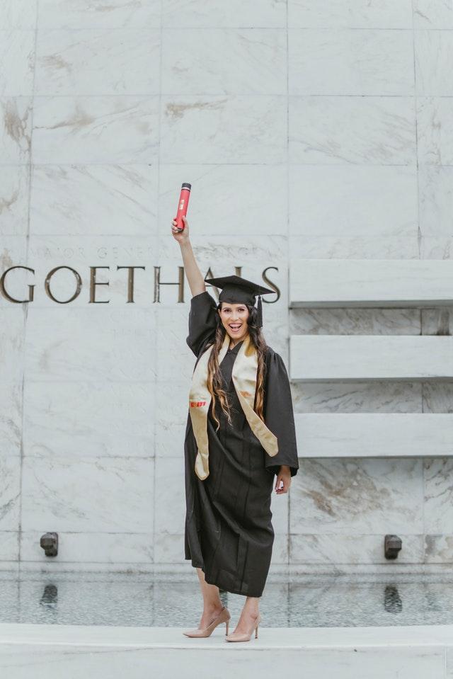 Mum posing for a graduation photoshoot. Photo credit: pexels.com