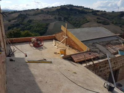 Cement for Roof on Top of Poroton at a new building site in Le Marche, Italy