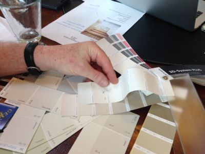 Comparing Paint Colors in a design planning meeting for a new house in Le Marche