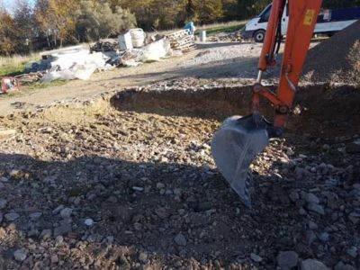 Flattening the Parking Area in front of a new house being built in Le Marche, Italy