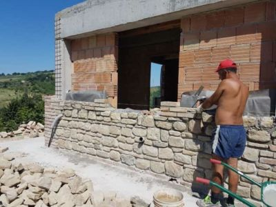 Halfway Up the Master Bathroom Wall on a new stone house in Le Marche