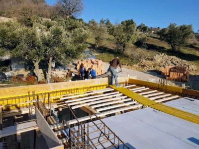 Hoisting A Structural Cage at new house construction in Le Marche