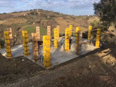 Concrete Forms and Olive at new house construction site in Le Marche