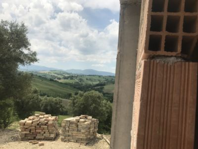 Leaning Out the Master Bath Window of a new house being built in Le Marche, Italy