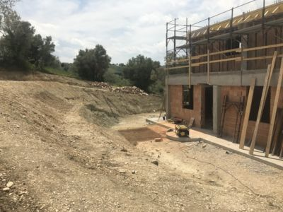 Our Front Side Problem Slope of a new house being built in Le Marche, Italy