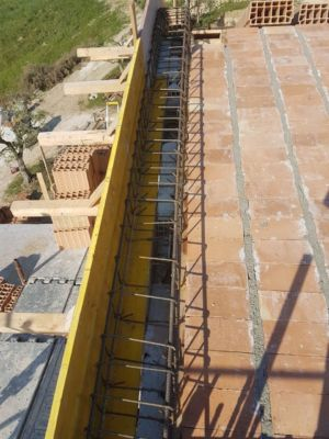 Pianelle Joints Filled and Rebar in Place on roof of a new house being built in Le Marche