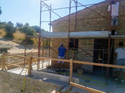 Pointed on Left, Unpointed in Center showing difference on wall of a new house being built in Le Marche