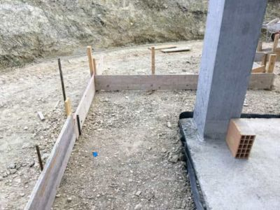 Southeast Corner Form Underlayment and Gravel at a new house being built in Le Marche Italy