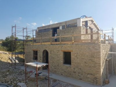 Stone Nearing Completion on Front of a new house being built in Le Marche