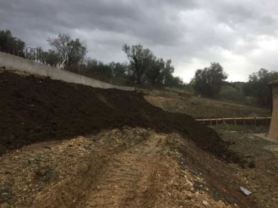 Topsoil on Front Slope in front of a new house being built in Le Marche, Italy