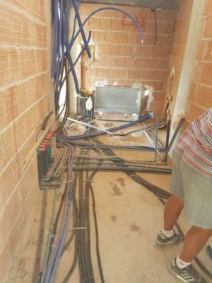 Utility Room Wiring and Pipes at a new stone house being built in Le Marche