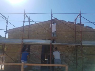 Working on North Side to complete tuckpointing of stone wall on a new house in Le Marche