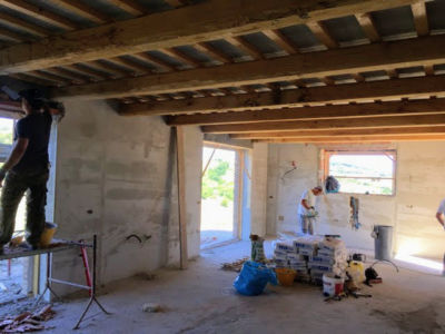 Working on Plaster in Main Room of a new house being built in Le Marche