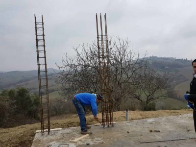 Working on Column Rebar at new house construction site in Le Marche